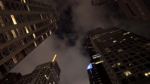 vidéos et rushes de new york city skyline cityscape. vertical view of tall skyscraper tower buildings - vue en contre plongée verticale