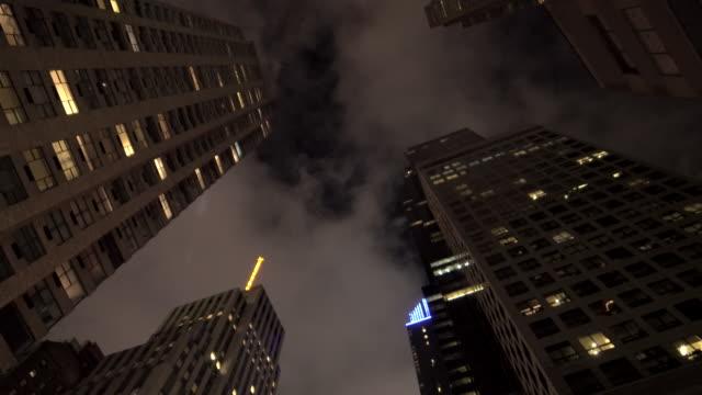 vídeos y material grabado en eventos de stock de new york city skyline cityscape. vertical view of tall skyscraper tower buildings - view from below