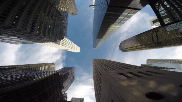 vidéos et rushes de new york city skyline cityscape. vertical view of tall skyscraper tower buildings - vue en contre plongée verticale