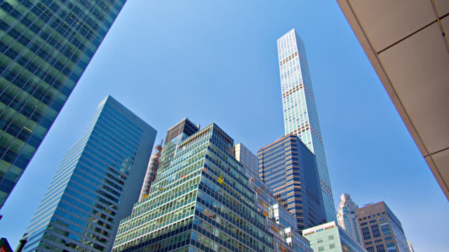 new york city skyline. financial business buildings grouped together. low angle. - low angle view stock videos & royalty-free footage