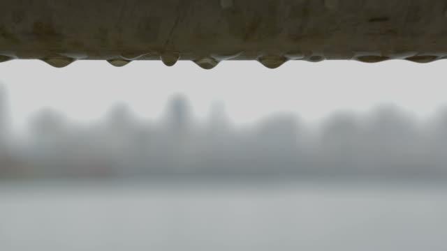 New York City skyline skyskape Rain drops fence in foreground