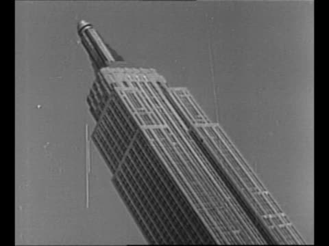 new york city skyline with empire state building towering above / montage empire state building / pov from inside elevator as it rises to the top of... - empire state building video stock e b–roll