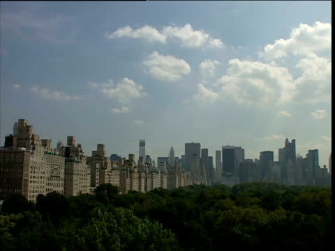 new york city skyline with trees of central park in foreground - natural parkland stock videos & royalty-free footage