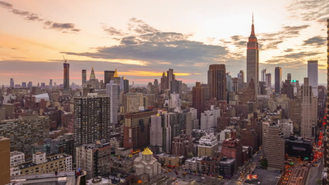 new york city skyline with urban skyscrapers at sunset. - nyc stock videos and b-roll footage