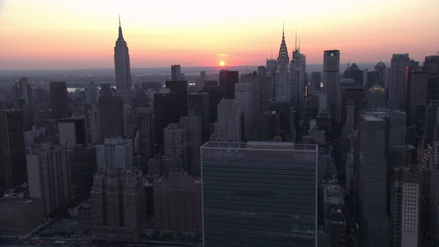 aerial new york city skylines, with sun setting beyond / new york, united states - 2000s style stock videos & royalty-free footage
