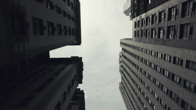 new york city skyscrapers from the street - black and white stock videos & royalty-free footage
