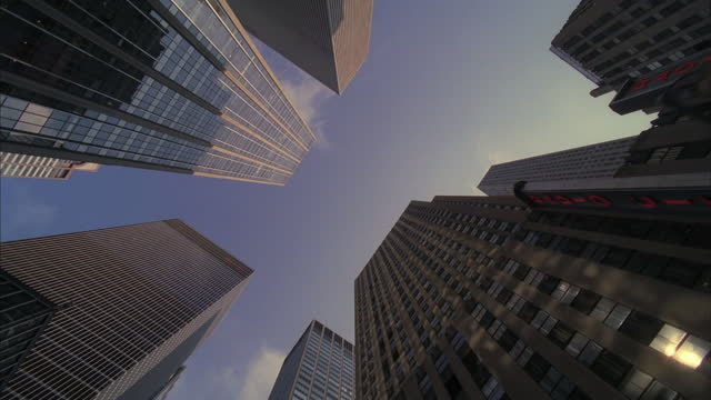 new york city skyscrapers tower above the street. - 1 minute or greater stock videos & royalty-free footage