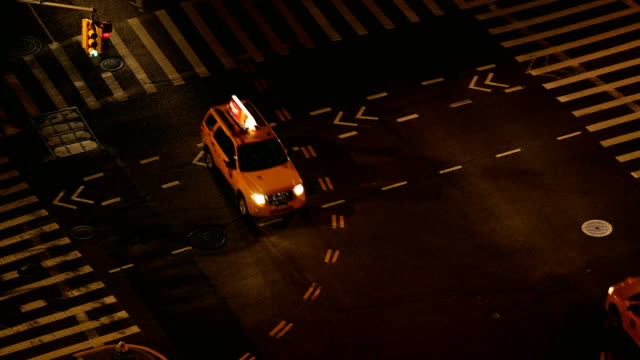 new york city street intersection - yellow taxi stock videos and b-roll footage