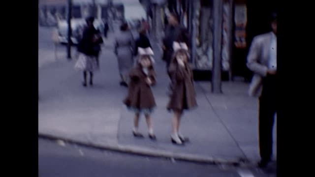 1953 new york city street scene, family in the city - new york city 1950s stock videos & royalty-free footage
