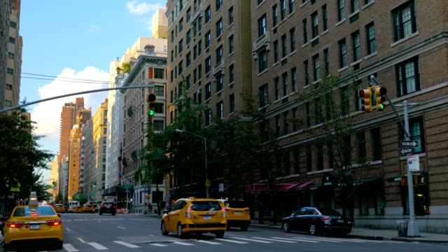 new york city street scene - yellow taxi stock videos & royalty-free footage