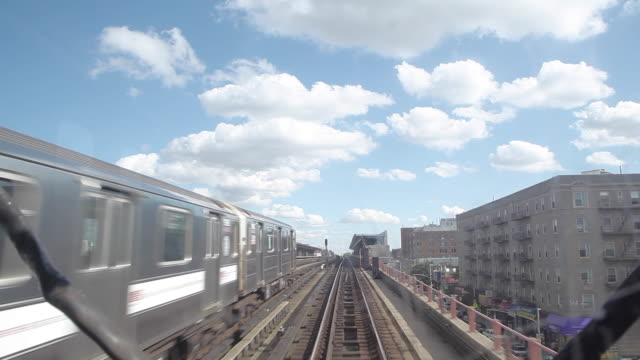 New York City Subway Train and White Clouds
