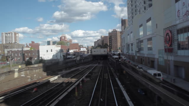 new york city subway train coming to tunnel - flushing meadows corona park stock videos and b-roll footage