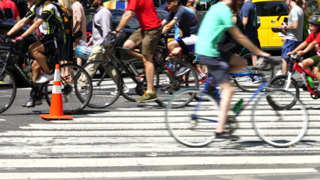 new york city summer streets were opened for people to play, run, walk and bike on aug. 19 2017. many bikers and people cross the union square intersection during the summer streets are opened. - union square new york city stock videos and b-roll footage