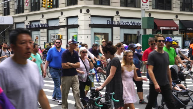 new york city summer streets were opened for people to play, run, walk and bike on aug. 19 2017. many bikers and people cross at park ave. and 23rd street intersection during the summer streets are opened. - large group of people stock videos & royalty-free footage