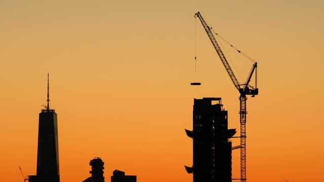new york city sunset construction - crane stock videos & royalty-free footage