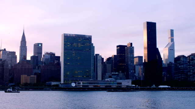 new york city sunset - united nations building stock videos and b-roll footage