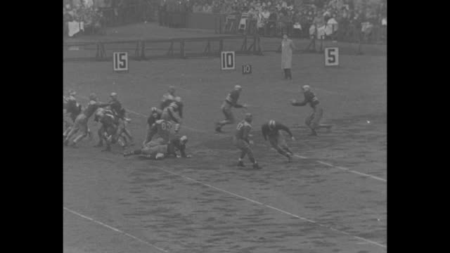new york city superimposed over football field / army v notre dame / army marching band on field / cadet feet marching around muddy field / stands... - regenmantel stock-videos und b-roll-filmmaterial