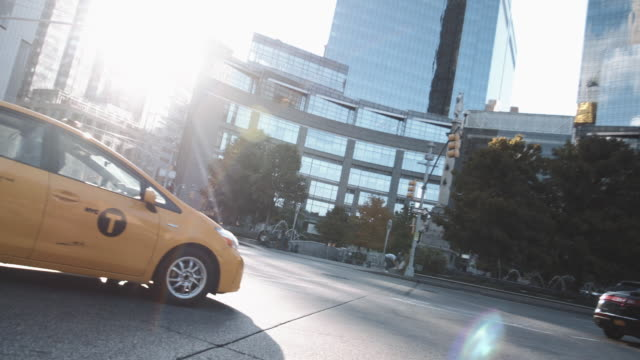new york city taxi cabs passing in front of columbus circle on a summer afternoon. - columbus circle stock videos & royalty-free footage