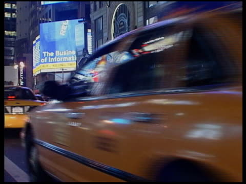 times square more general views of traffic people and displays at times square including a rickshaw police car and fire engine walking shot along... - dusk stock videos & royalty-free footage