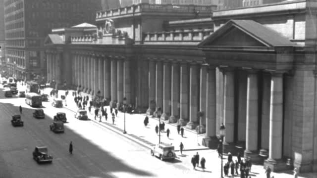 new york city traffic drives past the old pennsylvania station in a 1936 vintage film. - 1936 stock videos & royalty-free footage