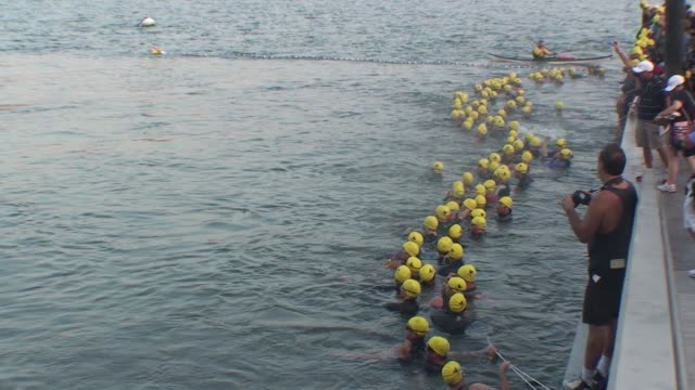 new york city triathlon swimmers in hudson river begin race - salmini stock videos and b-roll footage