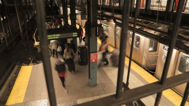 new york city union square subway station motion time lapse of commuters on platform. - union square new york city stock videos and b-roll footage