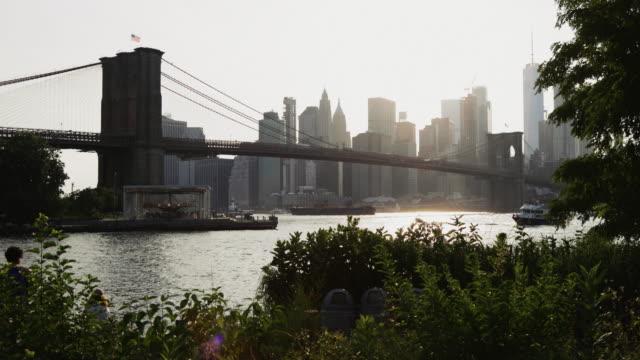 new york city views: the brooklyn bridge from dumbo - brooklyn bridge stock videos & royalty-free footage