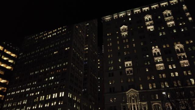 new york city wall street skyscraper offices night - office block exterior stock-videos und b-roll-filmmaterial