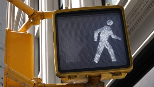 4k: new york city yellow walk sign - walk don't walk signal stock videos and b-roll footage