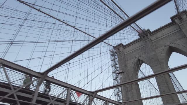 new york city's brooklyn bridge views from a moving car looking up - brooklyn bridge stock videos & royalty-free footage