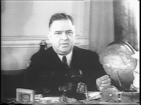 new york city's city hall / fiorello la guardia's house in the suburbs / in an office room la guardia makes a statement of guarded support for... - fiorello la guardia stock videos & royalty-free footage