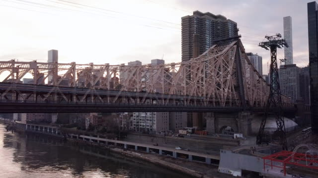 new york city's queensboro bridge at sunset - queensboro bridge stock videos & royalty-free footage