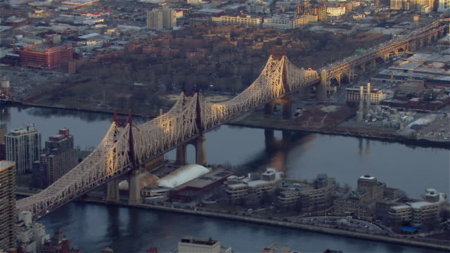 new york city's queensboro bridge, viewed from an aerial perspective at golden hour. - cantilever stock videos & royalty-free footage