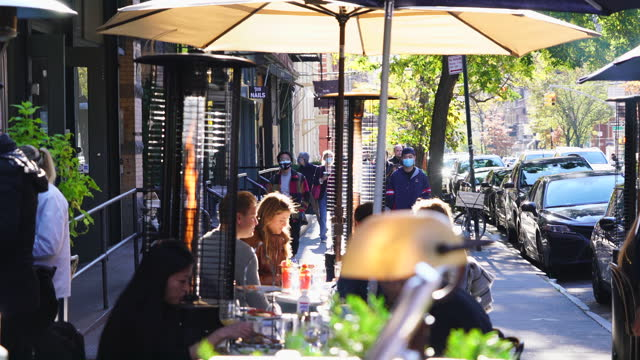 new york city's restaurant set the heater on the street during the pandemic of covid-19 for outdoor dining in autumn and winter cold seasons at... - 電気ストーブ点の映像素材/bロール