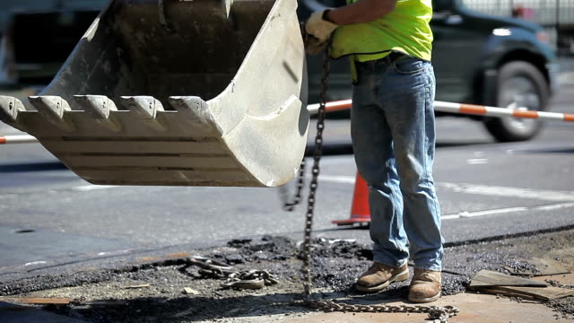 new york construction workers working on road maintenance - road construction stock videos and b-roll footage