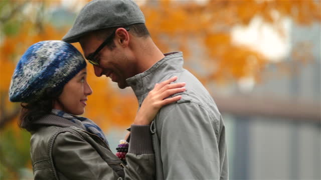 new york couple in love nuzzle and exchange kisses in autumn park (dolly-shot) - forehead stock videos and b-roll footage