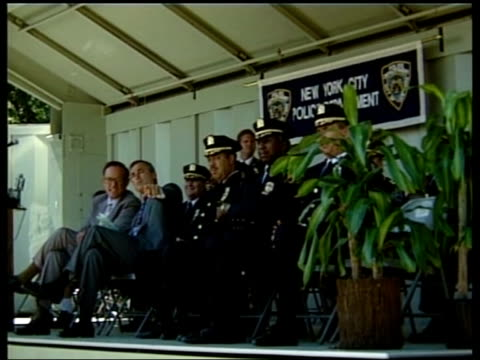 'out of order' series new york crime lib mat held bureau william bratton sitting with new york mayor rudolph giuliani on stage end - 1990 stock videos & royalty-free footage