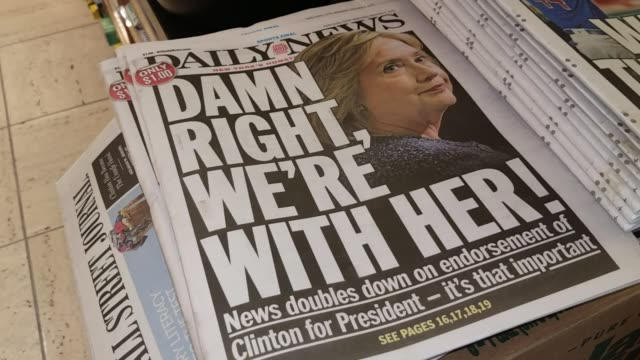 new york daily news paper with hillary clinton on cover - new york daily news stock videos and b-roll footage