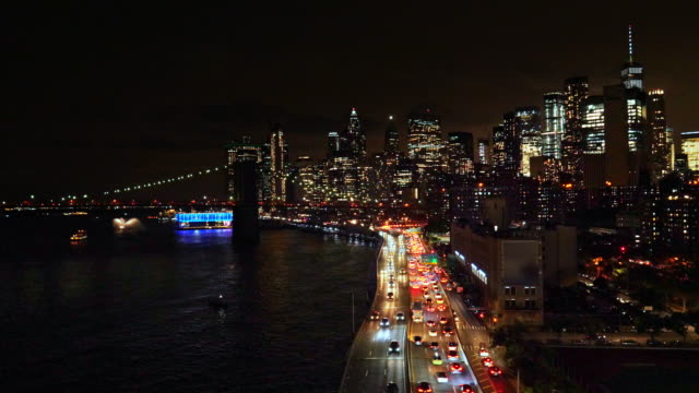 new york downtown skyline - aerial view after sunset - brooklyn bridge stock videos & royalty-free footage