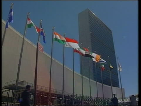 new york: ext gv flags flying outside united nations headquarters building cms union jack flag blowing in wind un building seen across river zoom in... - vereinte nationen stock-videos und b-roll-filmmaterial
