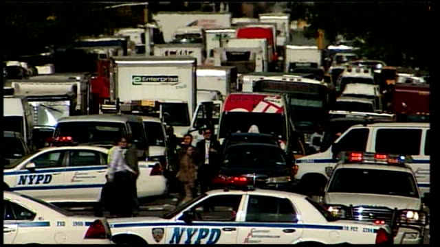 new york ext police cars blocking road for presidential motorcade presidential limousine along wide shot of united nations building with silhouette... - limousine stock-videos und b-roll-filmmaterial