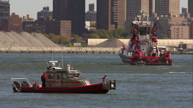 new york fire department boats standing in the hudson river - hudson river stock videos & royalty-free footage