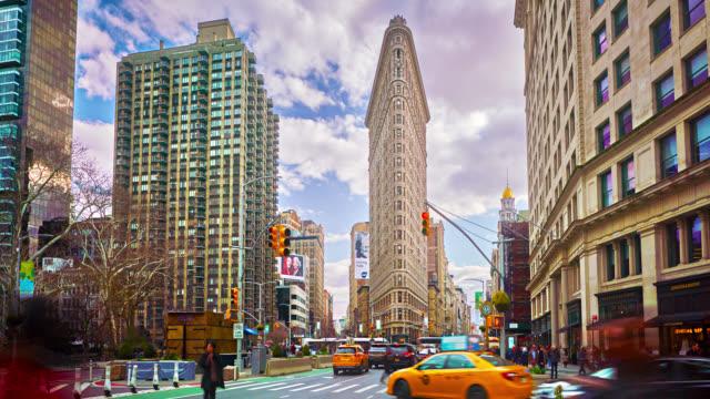 new york flatiron buildings. famous destination place. iconic view. - flatiron building manhattan stock videos & royalty-free footage