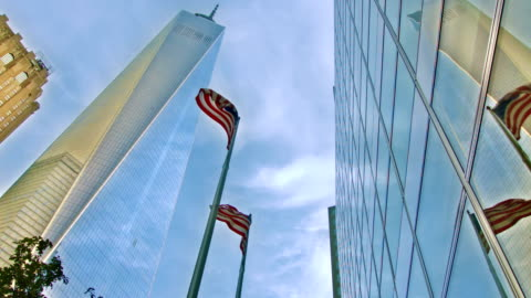 new york. freedom tower. american flag. - september 11 2001 attacks stock videos & royalty-free footage