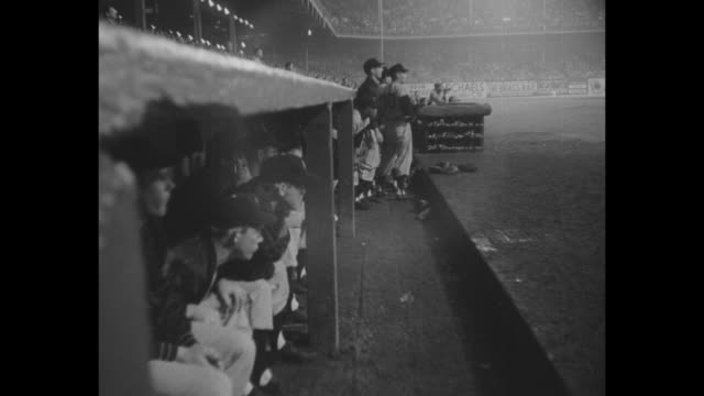 new york giants in dugout at ebbets field for game against the brooklyn dodgers crowds in stands / pan stands to baseball diamond / giants in dugout... - ebbets field video stock e b–roll