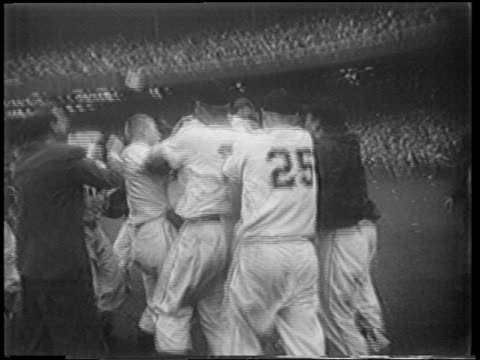new york giants players jumping in excitement at end of playoff game / nyc - 1951点の映像素材/bロール