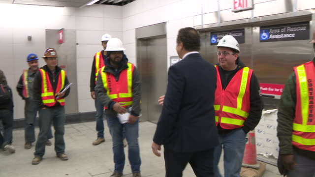 new york gov. andrew cuomo tours a new second avenue subway station prior to its opening. he greets nypd officers and mta employees. - governor stock videos & royalty-free footage