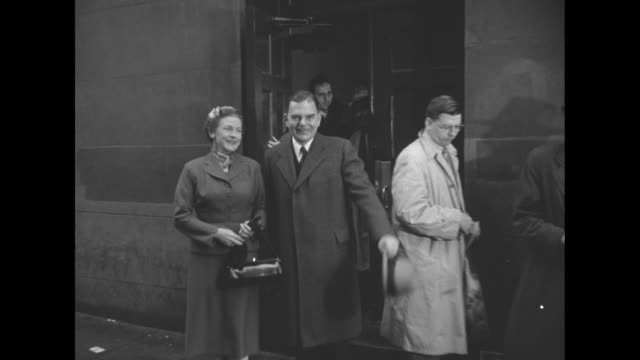 new york governor thomas edmund dewey, with wife frances eileen hutt dewey and mother mrs annie thomas dewey signs in voter role at table / voting... - betty thomas stock videos & royalty-free footage