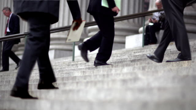 cinemagraph -new york man up business stairs - standing out from the crowd stock videos & royalty-free footage