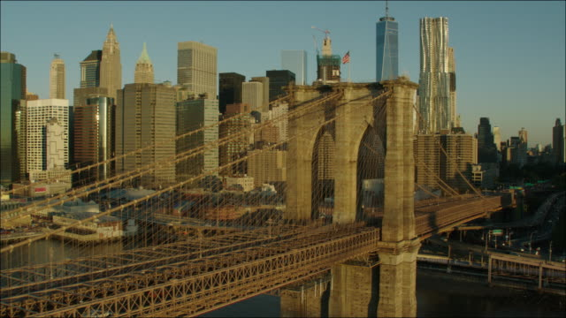 new york manhattan 4k sunrise aerial toward brooklyn bridge 2 - brooklyn bridge stock videos & royalty-free footage